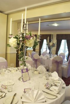 Tall candelabra decorated with silk ivy, hydrangea, lilac and viburnum