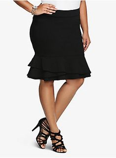 """This romantic style trumps all the rest! This little black skirt gets instant fashion-forward appeal with a fun layer of ruffles. It's a form-fitting look that's created to flatter your figure. Get ready to win some applause when you step out in this trend-on number.<ul><li> Size 14 measures 22 1/2"""" from center front</li><li>Rayon/nylon/spandex</li><li>Wash cold, dry flat</li><li>Imported</li></ul>"""