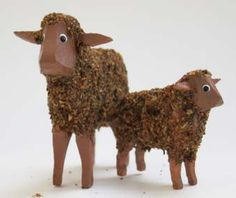 """Two delightful sheep from the Erzgebirge: brown with brown face flocked (wool effect) ewe (1-5/8"""") and lamb (1"""").  Hand-carved and painted ring animals. Made in Germany.  Available at www.mygrowingtraditions.com"""