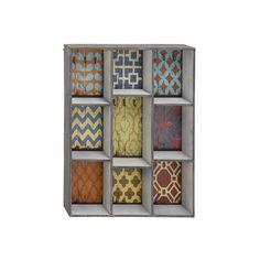 Wallpaper Wall Shelf with colorful prints - this would be fun inspiration for a Bohemian style DIY shelving unit as well   dotandbo.com