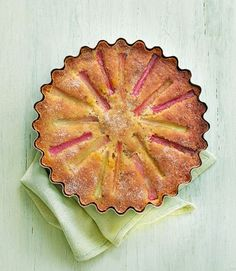 The flavours of rosemary and amaretti come together to make this beautifully light rhubarb cake with a herby orange glaze – serve with something creamy for afternoon tea. Delicious Magazine Recipes, Delicious Recipes, Orange Glaze Recipes, Amaretti Biscuits, Brownies, Rhubarb Cake, Food Tech, Think Food, Rhubarb Recipes