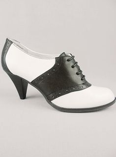 super cute. who knew the addition of a little heel could be a facelift for saddle shoes?