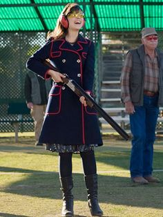 Navy coat red piping and gold buttons annnnd zoey is amazing and gun and dress tights boots!
