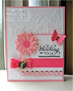 Uses Martha Stewart butterfly punch -- then glued those to the paper for a background. Brilliant idea!