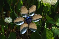 Spoons and forks recycled into adorable garden sculptures