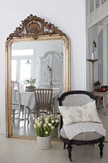 love the ornate mirror