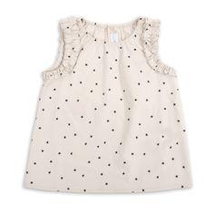 Blusa para niña, en color crema con estrellitas negras. EPK