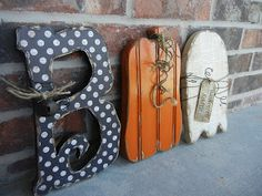 Fall wood craft ideas- one o is a pumpkin and one is a ghost