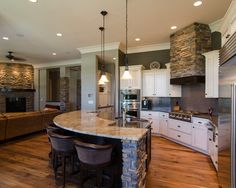 open concept gourmet kitchen - Google Search  I really like the stone work and the curved bar.