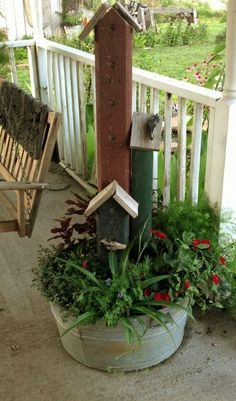 Old washtub planter with bird houses