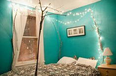 Oh my goodness so cute. I love the branches as bed posts. bedroom, fairy lights, lights, teal, turquoise