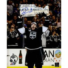 Drew Doughty Signed Los Angeles Kings 2014 Stanley Cup Overhead 16x20 Photo - Kings Star Drew Doughty has personally hand-signed this 16x20 2014 Stanley Cup Overhead Photo-Coming off recently winning the 2014 Stanley Cup Finals against the New York Rangers this young defencemen has no doubt been a huge component in the Kings success. Making his NHL debut at that young age of 18 he was named to the All-Rookie Team. He is also a two time Stanley Cup Champion which is a dream for any…