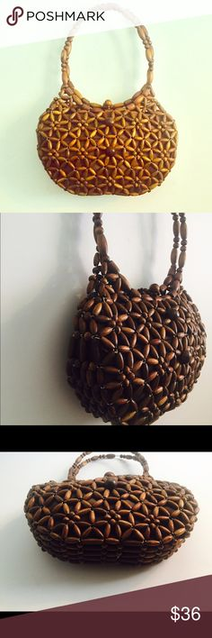 "Vintage 70s Beaded Wood Purse Handbag Vintage hand made beaded purse with a slip toggle closure, the inside has a slip Pocket and is lined in a brown nylon.   Material: wood, nylon lining Size: Medium   Measurements: Width:  12"" Height: 7.5"" Handle: 9"" from the center of the strap to the top of the bag  Condition: excellent very clean on the inside and out Vintage Bags"