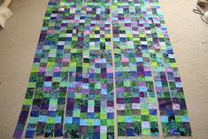 make a strip quilt then cut it up to make this.