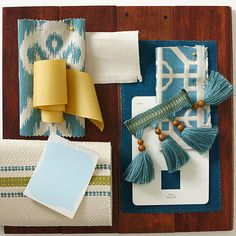Watercolor Blue  A room decorated with this peacock, ivory, and yellow palette can't help but feel happy. Trendy fabric motifs such as trellis and ikat feel timeless in blue and white.  Designer: Elaine Griffin  Getting Started:  Use a ratio formula to help you put together a color scheme. Choose one main color to serve as 40-60 percent of your color palette, then one to two supporting colors to comprise 30-40 percent of your color palette, and fill the remainder with one to two accents.