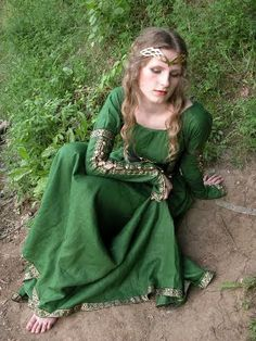 Medieval dress.I do believe this appearance would fit the description of Andromeda, Queen of the elves in my book.