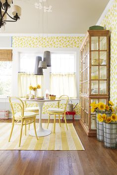 Lively yellows, punchy patterns, and galvanized metals hit a high note in this cheerful breakfast nook.