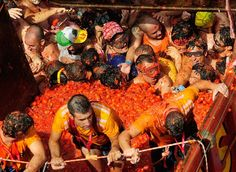 La Tomatina is the largest food fight festival organized every year in the town of Bunol in the Valencia region of Spain. Tens of metric tons of over-ripe tomatoes are thrown at each other in the streets during this day. The week-long festival features music, parades, dancing, and fireworks among other things. At the end of the fight the whole town square is colored red and rivers of tomato juice flow freely.