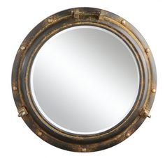 A dose of the sea for your interior...a 22 inch round antiqued metal porthole framed wall mirror in a rust finish. Mounts flush to any wall. Please allow 2-4 w