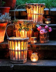 Garden lights, hurricane lamps in baskets lining stairs...should keep folks from kicking them over.