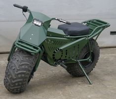 You don't need us to tell you how much fun it is to go off-road in an ATV. But the Tarus Motorcycle raises the off-road stakes even higher. This ATV disguised as a motorcycle is capable of slicing through. Motorcycle Camping, Camping Gear, Scrambler Motorcycle, Mini Bike, Motor Scooters, Car Wheels, Go Kart, Custom Bikes, Cool Bikes