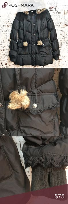 """Betsey Johnson Faux Fur Lined Puffer Down Jacket Classic down jacket by Betsey Johnson. Quilted puffer style. Detachable faux fur lined hood. Drawstrings with faux fur pom pom ends. Zipper and snap front closure. Snap flap pocket. Ruffle accent on back waist, pocket edges, and cuffs. Ribbed fitted cuff ends with thumb holes. Down and feather filled. In excellent condition! Approx. measurements: 20"""" flat armpit to armpit, 22"""" armpit to bottom hem, 33"""" shoulder to bottom hem. Betsey Johnson…"""