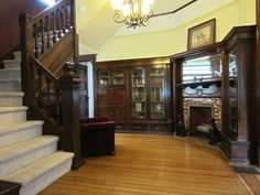 Gorgeous entryway with fireplace and built-ins in a Victorian-era home built in 1900 in Old Highland neighborhood of North Minneapolis. Victorian House Interiors, Victorian Homes, Victorian Era, Highland Homes, Grand Homes, Built In Cabinets, Tuscan Style, Built Ins, Old Houses