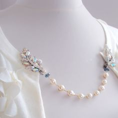 SALE: Vintage Rhinestone Sweater Guard Clips with Akoya Pearls and London Blue Topaz. $198.50, via Etsy.