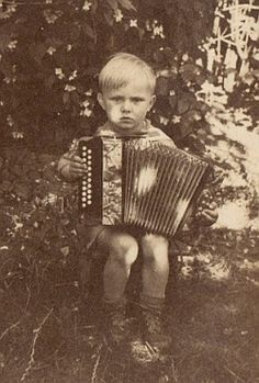 unknown child playing chromatic accordion