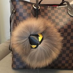 """Fur Monster Bag Charm / Keychain / Pom Pom Adorable taupe, black-tipped fox fur monster charm, similar to Fendi bug. Gold circle clasp attaches easily to a bag or clutch strap, or your keychain. Diameter is 7"""". Comes from non-smoking home.  BAG NOT INCLUDED. Accessories Key & Card Holders"""