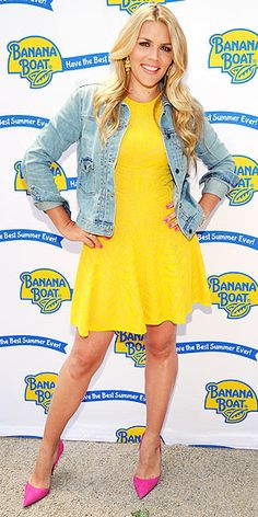 Last Night's Look: Love It or Leave It? | BUSY PHILLIPS | The name of the N.Y.C. event is Best Summer Ever (hosted by Banana Boat) and Busy is certainly dressed for the occasion in a yellow fit-and-flare dress, bright-pink Kurt Geiger heels and the official jacket of the season.