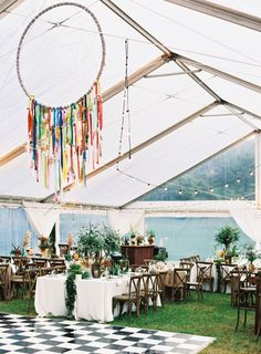 Love the rustic theme of this wedding with Southwestern decor including antlers, feathers and printed table runners.