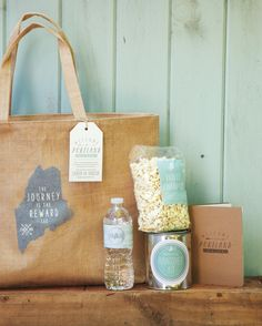 Burlap bags, stocked with snacks, a hangover kit, and the weekend's itinerary, welcomed guests to this Maine wedding.