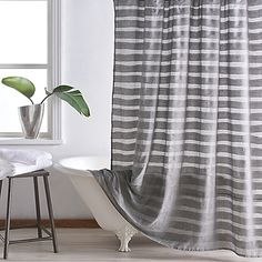 Create a relaxing retreat in your bathroom with the DKNY Loft Stripe Shower Curtain. Boasting cool, soothing grey hues, this softly striped fabric curtain brings the perfect touch of refined, contemporary elegance to your space.
