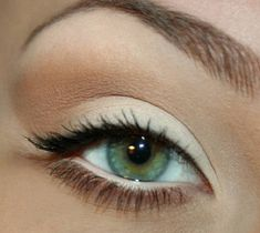 White shadow on lid, light brown in crease of eye, a little black eyeliner top lid, black mascara.