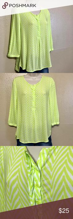 🎾 Neon Green Loose Fitting Hi Low Blouse 🎾 Neon Green Loose Fitting Hi Low Blouse   Brand: Stylus  Size: Small  Material: Rayon   This printed blouse has hidden button in the front as shown, buttons on the cuffs, and sleeves come to about the elbows.   This is a nice light flowing top that is very vibrant.  #155 Stylus Tops Blouses