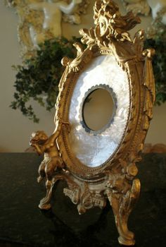 Gilded Bronze Mother of Pearl French Rococo Easel Picture Frame Cherub