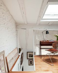 i love that the small attic was turned into a work space! and please--- exposed beams and brick = my favorite!