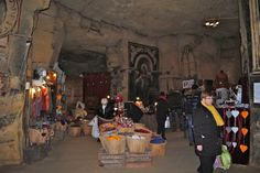 In Valkenburg, Netherlands they hold their Christmas Markets underground in caves. The caves have been under the town's castle for centuries and have wonderful stories of their own.   Valkenburg Castle and Velvet Cave with Christmas Market (Kasteelruïne & Fluweelengrot) Valkenburg Underground Christmas Market; germanyja.com