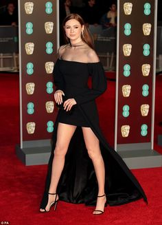 The actress, 30, returned to her British roots as she graced the star-studded red carpet at the 71st BAFTA Awards at London's Royal Albert Hall on Sunday.
