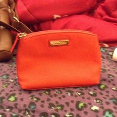 Calvin Klein cosmetic bag red/orange Cosmetic bag medium size new used a few times. Redish Orange color Calvin Klein Bags Cosmetic Bags & Cases