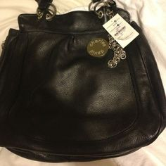 Charles David handbag New Charles handbag with charm brand new haven't been used. Found it while sprig cleaning Charles David Bags