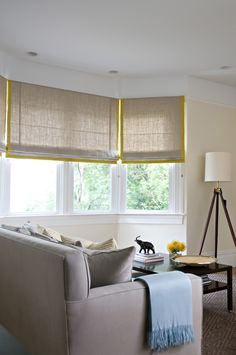 Love this yellow tape around linen roman shades.