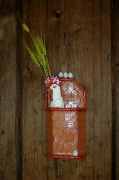 "Wall Vase with removable chicken ""tube"" that holds flowers. There are two chickens for the vase."