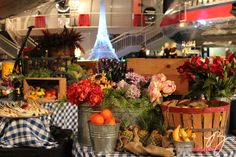 An international travel themed party at the Museum of Flight. French buffet decorated to look like a Parisian Market / PJ Hummel & Co