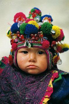 Pakistan, Baltistan, Khaplu, Baby boy with traditional dress. Photograph by Christophe Boisvieux