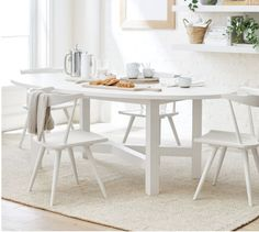 Comb through 12 of the best white round kitchen tables that are designers' favorites, and a range of budgets from cheap to high end. Faux marble tops, or the real thing! Solid wood... all kinds of dining table inspiration and links for your kitchen home decor. White Oval Dining Table, Oval Kitchen Table, Pedestal Dining Table, Wooden Dining Tables, Modern Dining Table, Dining Arm Chair, Dining Rooms, Kitchen Dining, Expandable Dining Table