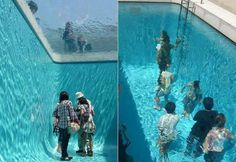 Have you ever seen someone walk inside a water pool without wetting his clothes? It's really amazing and stunning scene that I never seen before.This is a fake pool in Japan with a glass slice at the top of the pool covered by water and the people are below this glass.