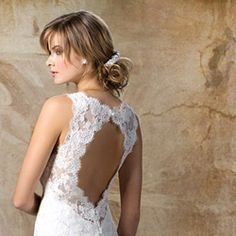 Alencon lace on embroidered tulle v-neck sheath gown with key hole back in ivory....