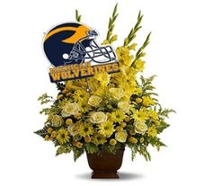 Honor a University of Michigan fan with a grand display of bold yellow blossoms and a U of M banner. At more than three feet tall, it will add a touch of brightness to any tribute.